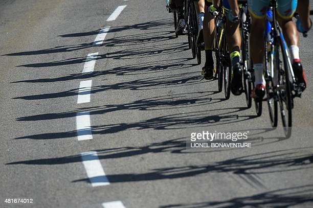 Shadows of wheels are pictured during the 1865 km eighteenth stage of the 102nd edition of the Tour de France cycling race on July 23 between Gap and...