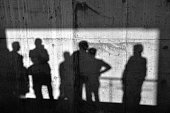 Men shadows on the concrete wall.