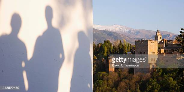 Shadows on whitewashed wall beside Mirador de San Nicolas in Albaicfn district with the Alhambra beyond.
