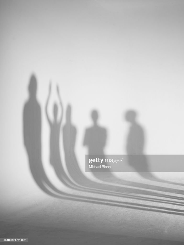 Shadows standing in front of white background : Stock Photo