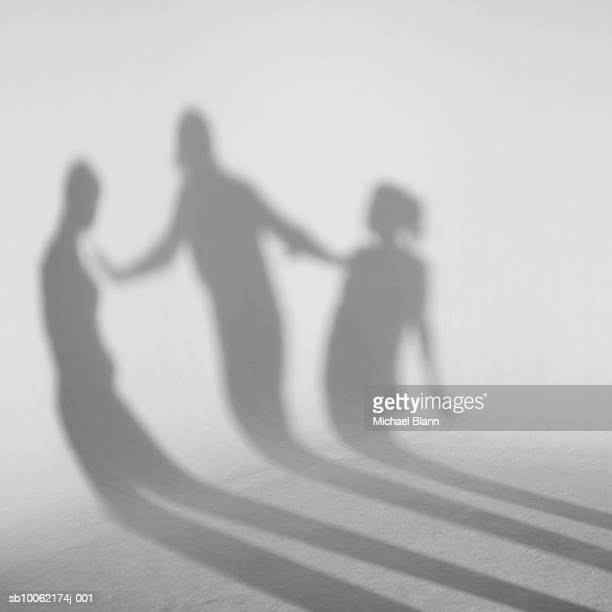 Shadows standing in front of white background