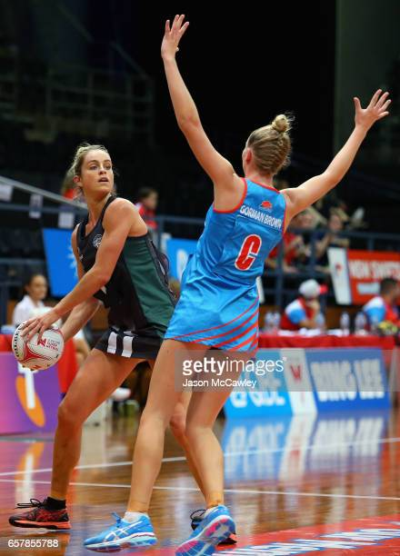 Shae Brown of the Magpies looks to pass during the round six ANL match between the Netball NSW Waratahs and the Tasmanian Magpies at Sydney Olympic...