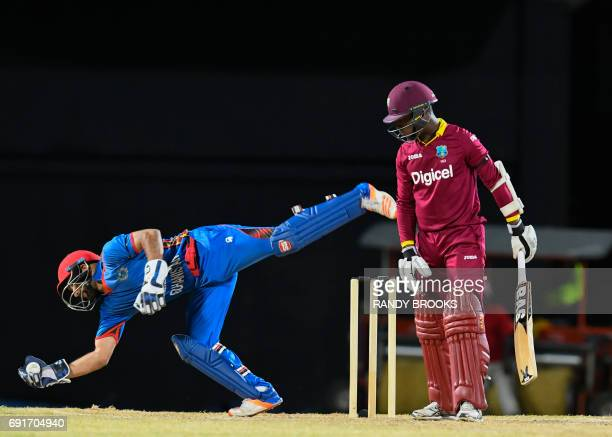 Shafiqullah Shafaq of Afghanistan stops Jason Mohammed of West Indies from scoring during the 1st T20i match between West Indies and Afghanistan at...