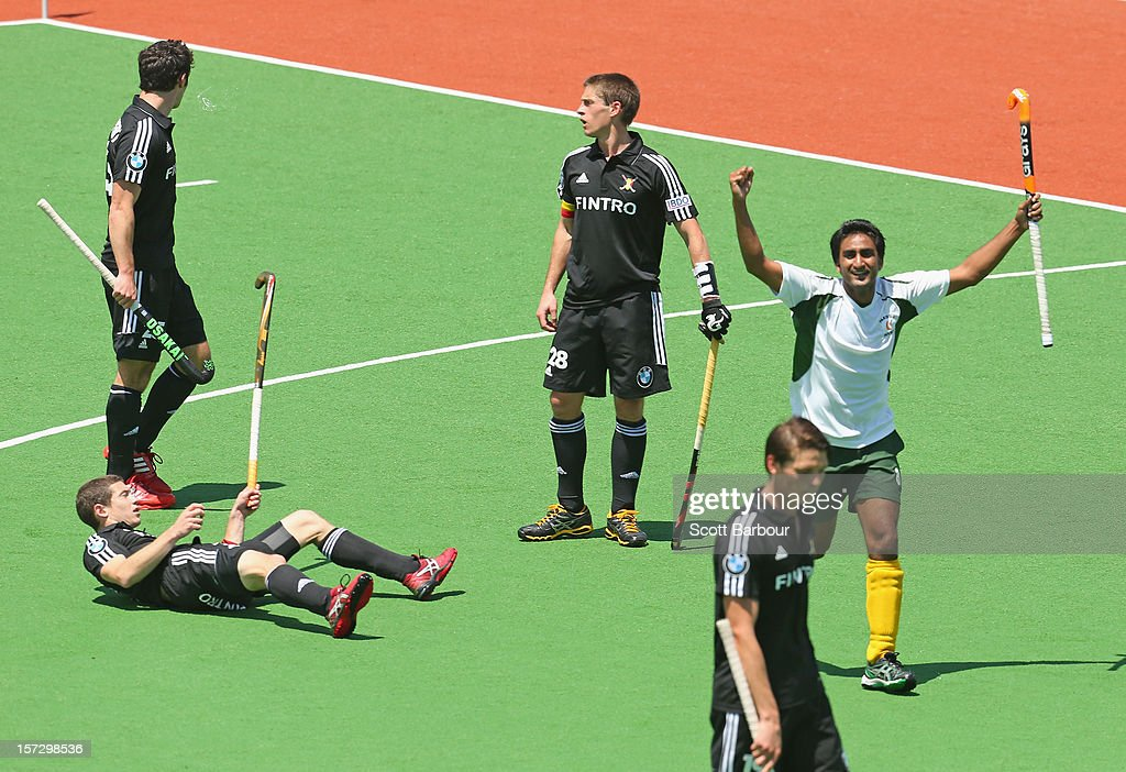 Shafqat Rasool of Pakistan celebrates after scoring a goal during the match between Belgium and Pakistan during day two of the Champions Trophy on December 2, 2012 in Melbourne, Australia.