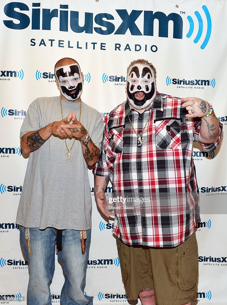 Shaggy 2 Dope (L) and Violent J of Hip hop duo 'Insane Clown Posse' visit SiriusXM Studios on July 30, 2013 in New York City.