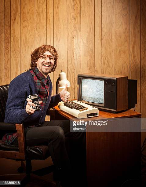 Shaggy haired Geeky Nerd Man with vintgae computer and calculator