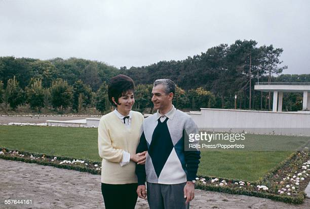 Shah of Iran Mohammad Reza Pahlavi pictured with Queen consort of Iran Farah Diba outside a residential house circa 1966