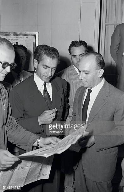 Shah Reads Report of Coup Rome Italy Shah Mohammed Reza Pahlevi of Iran reads the reports of the Iranian coup which resulted in the arrest of Premier...