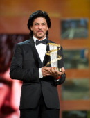Shah Rukh Kahn receives an award during the Marrakech International Film Festival 2011 Opening Ceremony on December 2 2011 in Marrakech Morocco