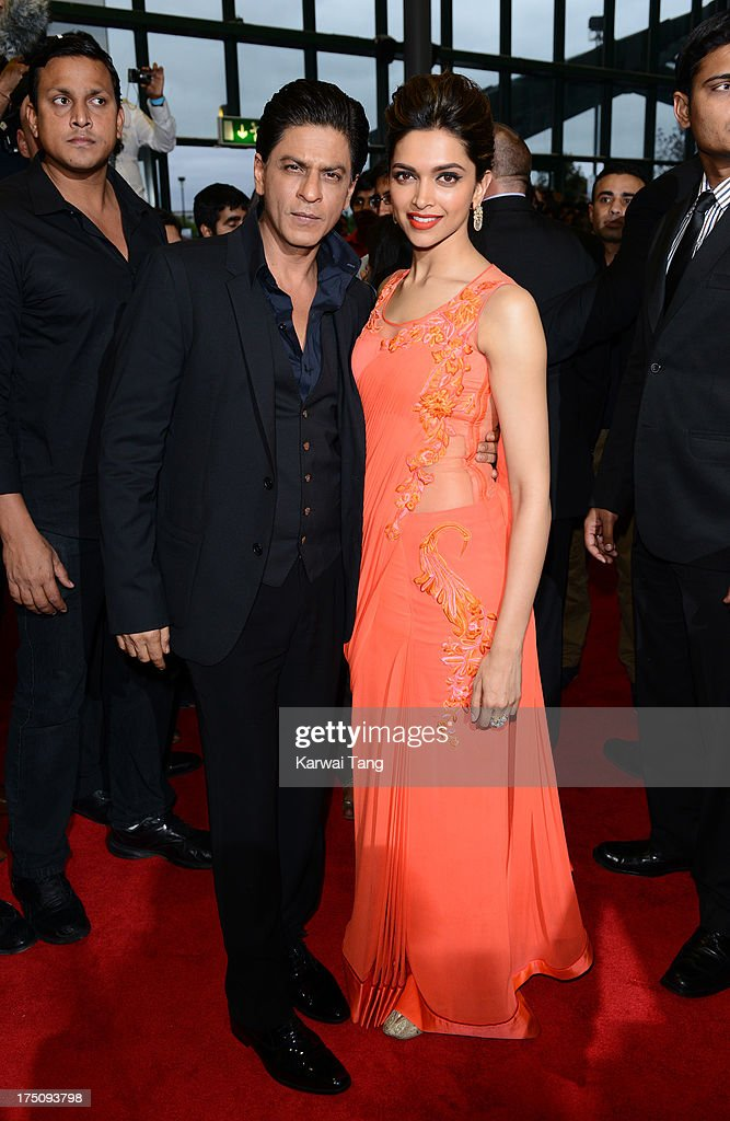 <a gi-track='captionPersonalityLinkClicked' href=/galleries/search?phrase=Shah+Rukh+Khan&family=editorial&specificpeople=664337 ng-click='$event.stopPropagation()'>Shah Rukh Khan</a> and <a gi-track='captionPersonalityLinkClicked' href=/galleries/search?phrase=Deepika+Padukone&family=editorial&specificpeople=869186 ng-click='$event.stopPropagation()'>Deepika Padukone</a> attend a special screening of 'Chennai Express' at Cineworld Feltham on July 31, 2013 in Feltham, England.