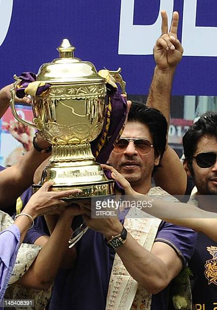 Shah Rukh Khan owner of IPL cricket team Kolkata Knight Riders holdS up the IPL Twenty20 champion's trophy during celebrations in front of the...