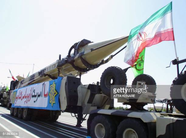 Shahab 3 missiles are driven past Iranian President Mohammad Khatami at the mausoleum of Iran's late leader Ayatollah Ruhollah Khomeini on Army Day...