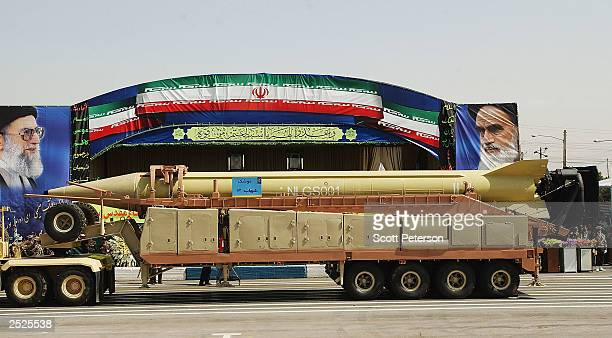 Shahab3 ballistic missile is displayed as Iranian military forces launch 'Sacred Defense Week' with a show of force south of Tehran on September 22...