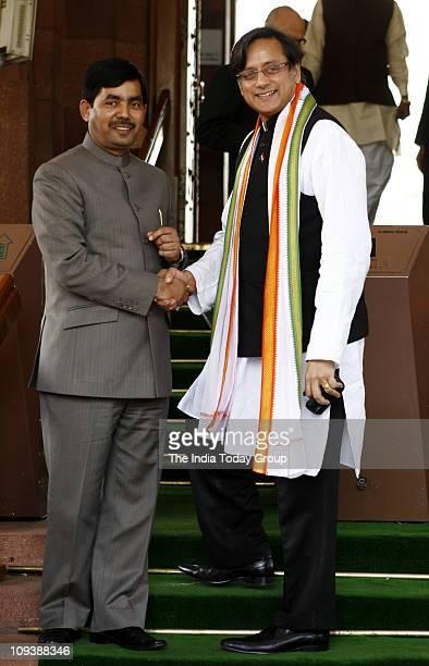 Shahanawaz Hussain and Shashi Tharoor at the parliament on Wednesday February 23 2011 in New Delhi