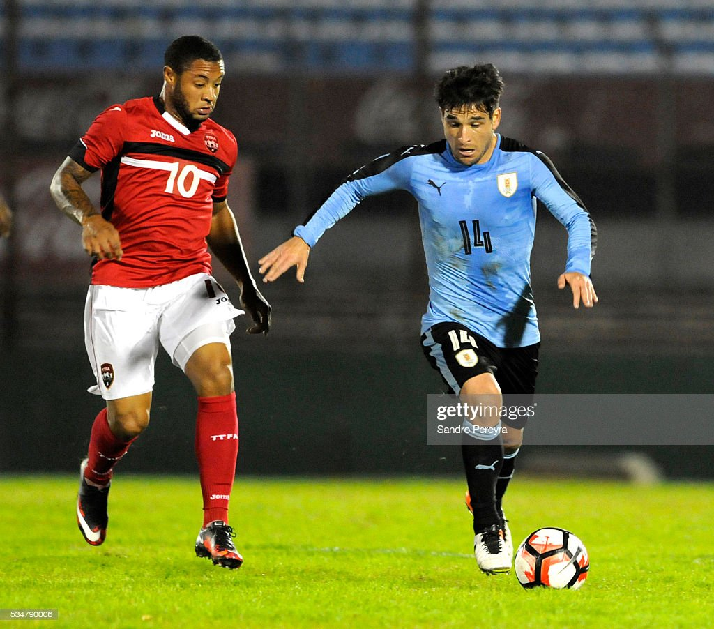 Shahdon Winchester of Trinidad Tobago and Nicolas Lodeiro of Uruguay fight for the ball during an international friendly match between Uruguay and...