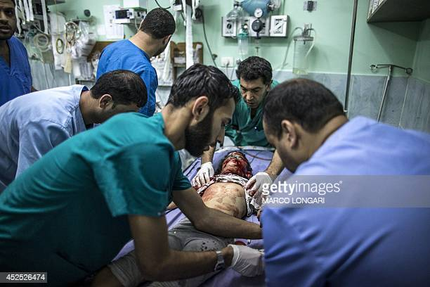 Shahed Qishtah a nineyearold Palestinian girl receives medical care at an emergency room of the Kamal Adwan hospital in Beit Lahia after she was...