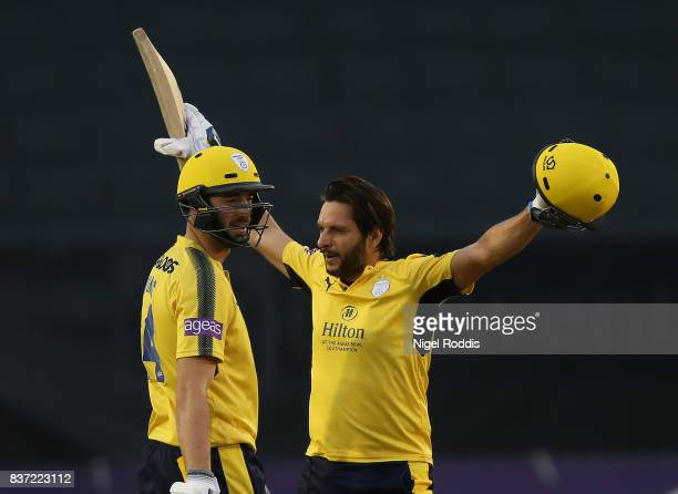Shahid Afridi of Hampshire celebrates his century with James Vince during the NatWest T20 Blast at The 3aaa County Ground on August 22 2017 in Derby...