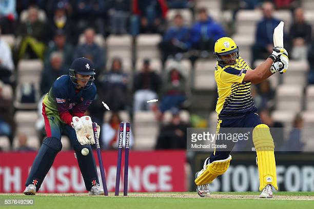 Shahid Afridi of Hampshire is bowled by Fabian Cowdrey as wicketkeeper Sam Billings of Kent looks on during the NatWest T20 Blast match between...