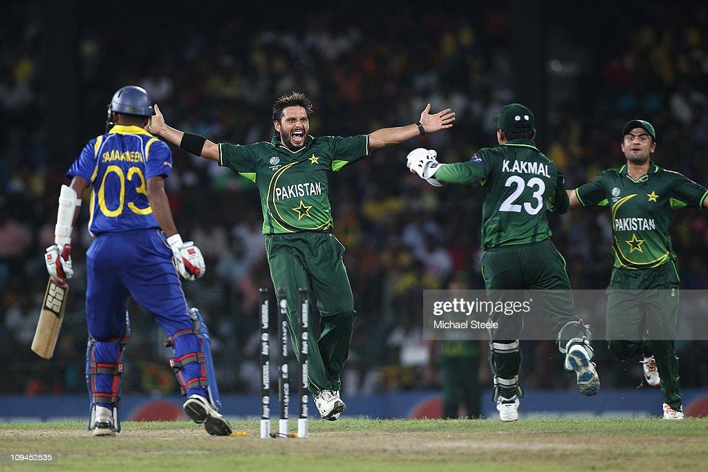 Shahid Afridi (2L) of Pakistan celebrates taking the wicket of Thilan Samaraweera (L) stumped by Kamran Akmal (#23) during the Pakistan v Sri Lanka 2011 ICC World Cup Group A match at the R. Premadasa Stadium on February 26, 2011 in Colombo, Sri Lanka.