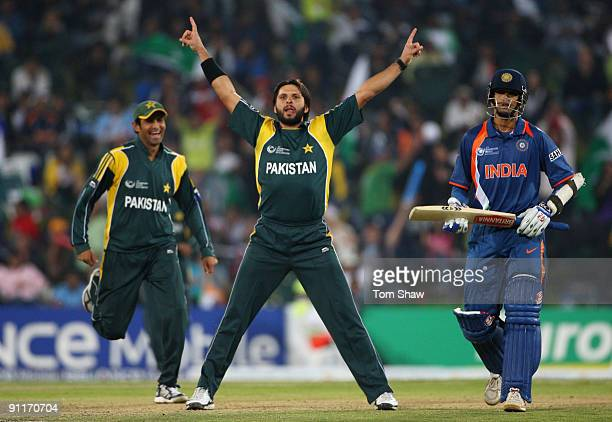Shahid Afridi of Pakistan in celebration after taking the wicket of Mahendra Sigh Dhoni of India during the ICC Champions Trophy group A match...