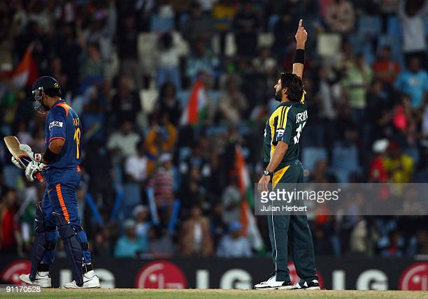 Shahid Afridi watches as Virat Kohli of India walks off after his dismissal during The ICC Champions Trophy Group A Match between India and Pakistan...