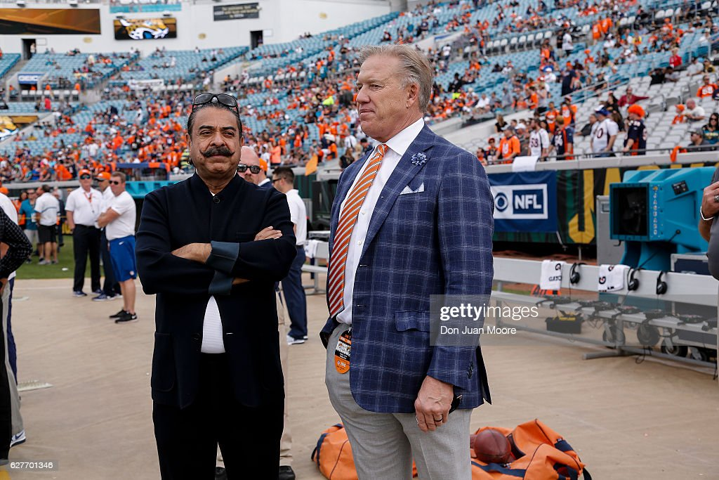 Shahid Khan, owner of the Jacksonville Jaguars talk with John Elway, GM of the Denver Broncos before the game at EverBank Field on December 4, 2016 in Jacksonville, Florida. The Broncos defeated the Jaguars 20 to 10.