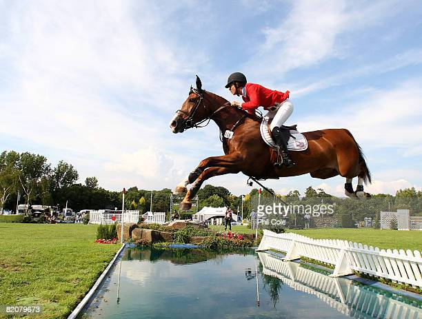 ShahinianSimpson N ridding SRF Dragon fly of the United States of America clears the water jump during the Longines King George V Gold Cup on July 27...