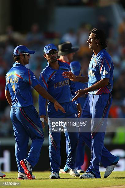 Shahpur Zadran of Afghanistan is congratulated after dismissing Steven Smith of Australia during the 2015 ICC Cricket World Cup match between...