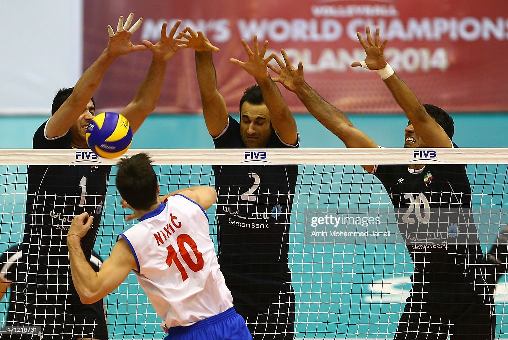 Shahram Mahmoudi (L), Adel Gholami and Alireza Mobasheri of Iran in action against <a gi-track='captionPersonalityLinkClicked' href=/galleries/search?phrase=Milos+Nikic&family=editorial&specificpeople=4050380 ng-click='$event.stopPropagation()'>Milos Nikic</a> of Serbia during the Volleyball World League between Iran and Serbia on June 23, 2013 in Tehran, Iran Azadi Complex.