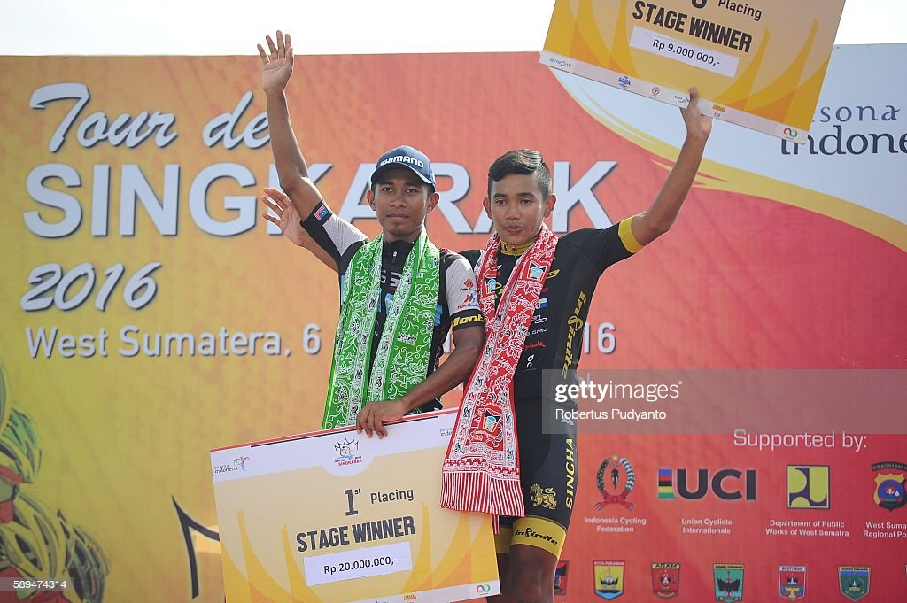 Shahrul Mat Amin of Terengganu Cycling Team and Jamalidin Novardianto of Singha Infinite Cycling Team Singapore celebrate on the podium during...