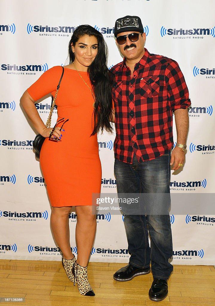 Shahs of Sunset cast members Asa Soltan Rahmati (L) and Reza Farahan visit SiriusXM Studios on November 6, 2013 in New York City.