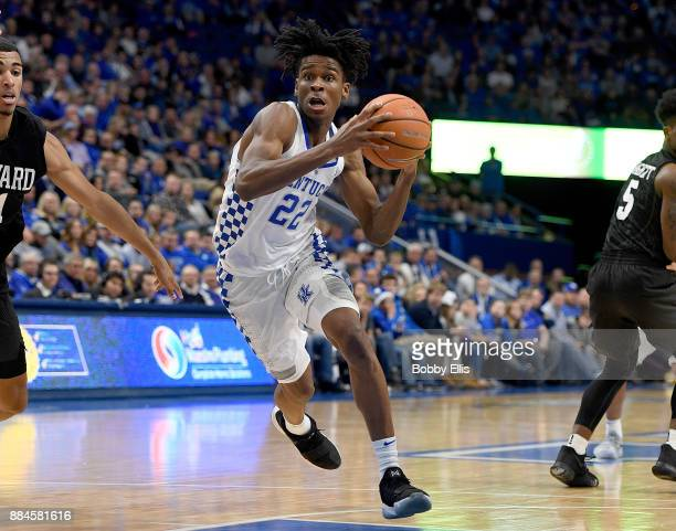 Shai GilgeousAlexander of the Kentucky Wildcats drives to the basket during the second half of the game between the Kentucky Wildcats and the Harvard...