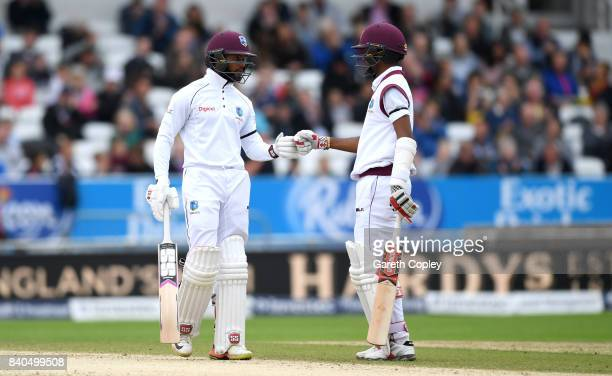 Shai Hope and Kraigg Brathwaite of the West Indies touch gloves during day five of the 2nd Investec Test between England and the West Indies at...