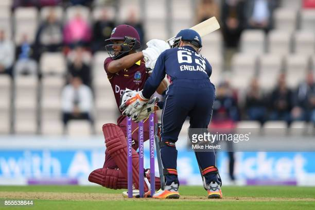 Shai Hope of West Indies hits a boundary as Jos Buttler of England looks on during the 5th Royal London One Day International between England and...