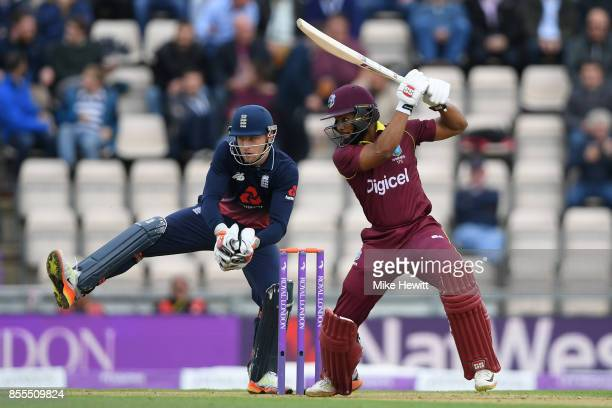 Shai Hope of West Indies hits out as Jos Buttler of England looks on during the 5th Royal London One Day International between England and West...