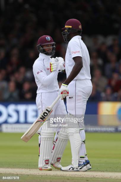 Shai Hope of West Indies is congratulated by his captain Jason Holder after reaching a half century during day three of the 3rd Investec Test match...
