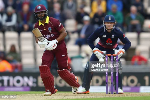 Shai Hope of West Indies plays to the onside as England wicketkeeper Jos Buttler looks on during the 5th Royal London One Day International match...