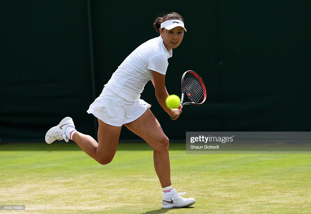 Shai Peng of China plays a backhand during the Ladies Singles first round match against Sloane Stephens of The United States on day four of the Wimbledon Lawn Tennis Championships at the All England Lawn Tennis and Croquet Club on June 30, 2016 in London, England.