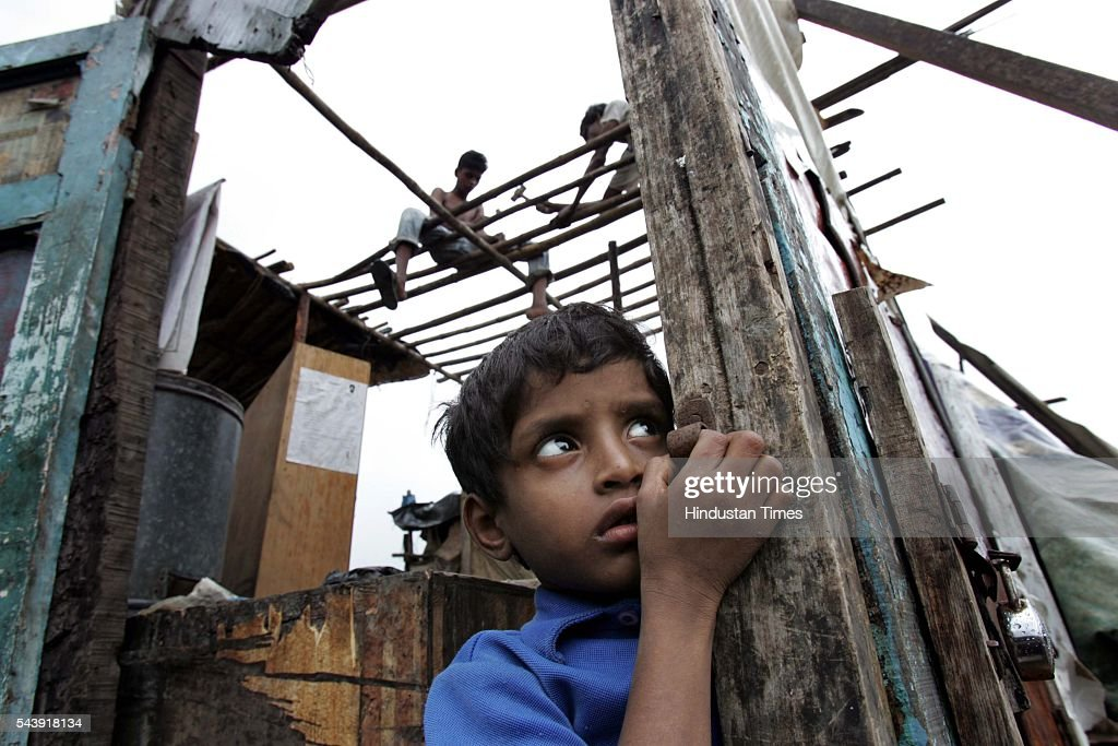 Shaikh Makdum, 5, waits in anticipation of food at his broken house in Naya Nagar, Dharavi. He and his family have not got any aid from the government or any other agency as yet.