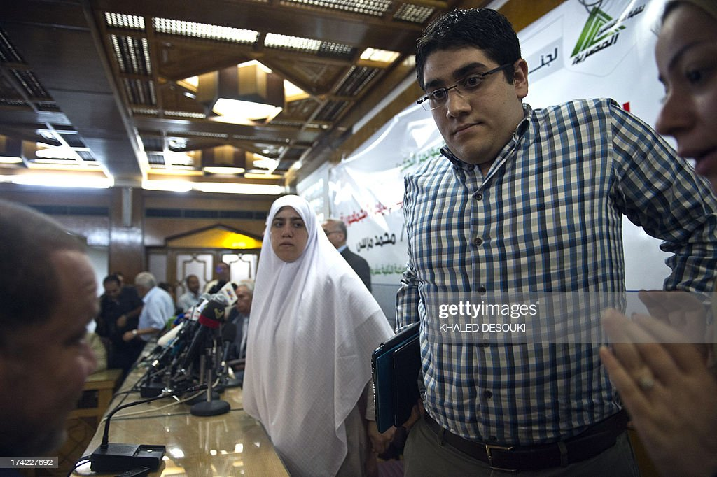 Shaimaa (L) and Abdulah (R) Mohamed Morsi, the sons and daughter of Egypt's ousted president Mohamed Morsi leave after a press conference in Cairo on July 22, 2013. The family of Morsi is to take legal action against Egypt's army chief, General Abdel Fattah al-Sisi, for 'kidnapping' the Islamist president, Shaimaa said.