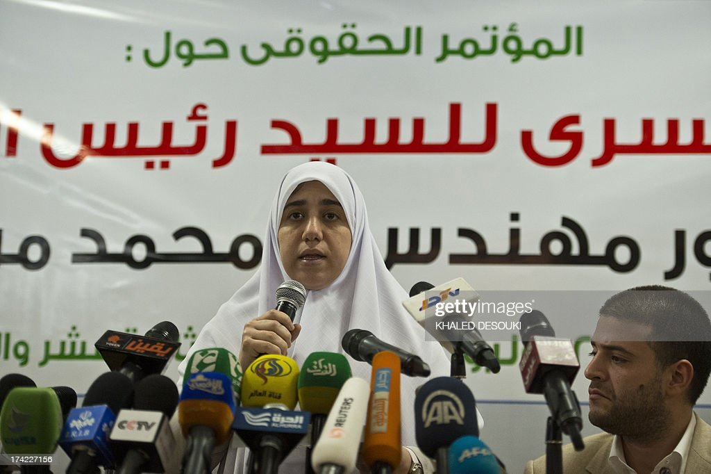 Shaimaa Mohamed Morsi, the daughter of Egypt's ousted president Mohamed Morsi speaks during a press conference as his son Osama listens on, in Cairo on July 22, 2013. The family of Morsi is to take legal action against Egypt's army chief, General Abdel Fattah al-Sisi, for 'kidnapping' the Islamist president, Shaimaa said.