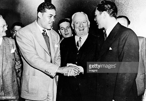 Shake Hands between the american boxer and world heavyweight champion Joe Louis known as The Brown Bomber and the German heavyweight boxer and Max...