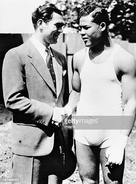 Shake Hands between the American boxer and world heavyweight champion Joe Louis called The Brown Bomber and the German heavyweight boxer and 1930 to...