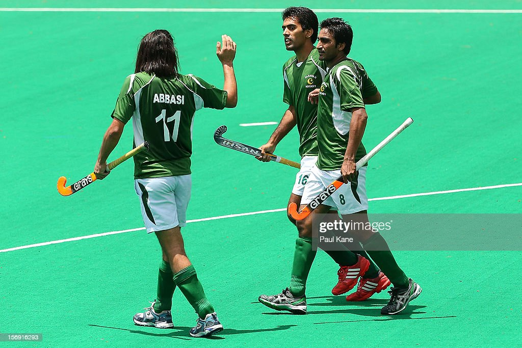 Shakeel Abbasi, Ali Shan and Shafqat Rasool of Pakistan celebrate a goal as Danish Mujtaba of India walks past during day four of the 2012 International Super Series at Perth Hockey Stadium on November 25, 2012 in Perth, Australia.