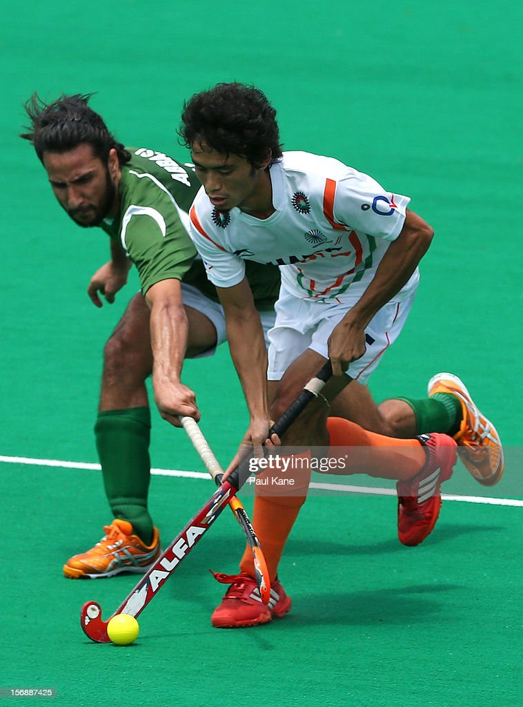 Shakeel Abbasi of Pakistan and Kothajit Singh Khadangbam of India contest for the ball in the mens India v Pakistan game during day three of the 2012 International Super Series at Perth Hockey Stadium on November 24, 2012 in Perth, Australia.