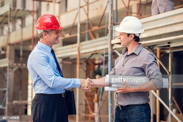 Shakehand on a construction site