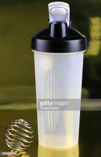Shaker bottle and wire whisk ball for blending nutritional health drinks