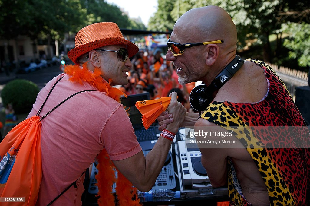 A DJ shakes hands with a supporter on the roof of a truck during the Madrid Gay Pride Parade 2013 on July 6, 2013 in Madrid, Spain. According to a new Pew Research Center survey about homosexual acceptance around the world, Spain tops gay-friendly countries with an 88 percent acceptance rate.