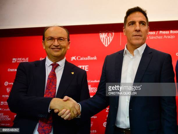shakes hands with Sevilla's president Jose Castro shakes hands with Sevilla's new coach Argentinian Eduardo Berizzo during his presentation to the...