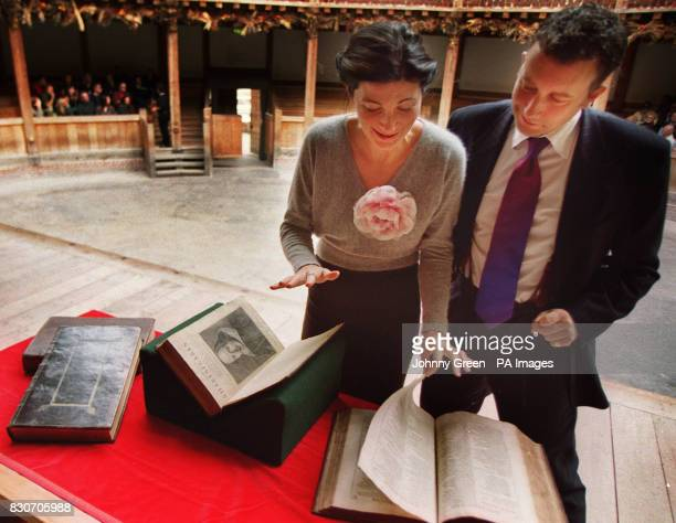 Shakespearian actors Jasper Britton and Eve Best looking at the opening pages of The First Folio dated 1623 part of William Shakespeare's Comedies...